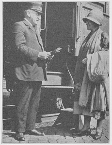 Pullman conductor John W. Zimmer greating a passenger, Burlington, Iowa, 1925.