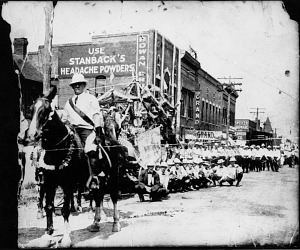 Parade in downtown Spencer, 1920s