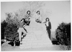 Caroline Millbank, Janet McDonnel, Ethel May Krockenberger, and Mary Jane Pecora on Texas sign.