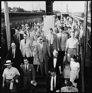 Commuters returning from Chicago on the Illinois Central, Park Forest, Illinois, 1954