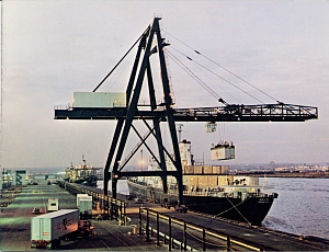 This photograph from a Sea-Land brochure illustrated the transfer of a trailer (cargo container) from truck to ship