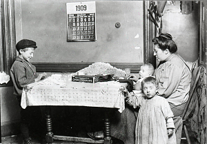 Mother and children filling chocolate cigarettes, New York City, around 1911