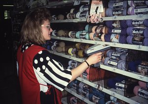 Retail employee using Laser Radio Terminal barcode scanner for inventory control, about 1992