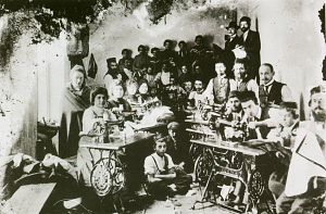 Tailors, seamstresses, and apprentices in a sewing workshop, Tarnow, Galicia (in present-day Poland), 1905