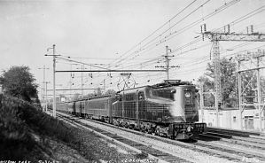 An electric-powered locomotive pulls a train at 90 miles per hour between Washington, D.C., and New York City in the late 1930s.