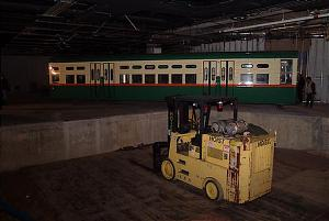 CTA car 6719 is raised to the upper level of the Transportation Hall, January 7, 2003
