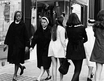 Nuns pass girls in mini-skirts
