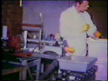 Carrot-slicing machine in use, 1960s