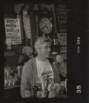 Buffalo Bill's founder Bill Owens behind the bar at his brewpub, 1989