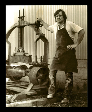 Jack McAuliffe at New Albion Brewing Company, with his barrel washer, around 1979