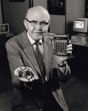 Jack Kilby with prototype electronic calculator and microchips, around 1987
