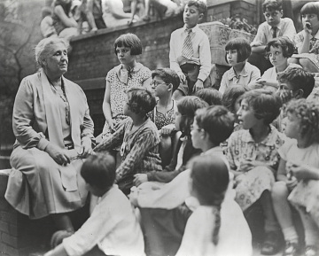 Cofounder Jane Addams with children at Hull House, 1933