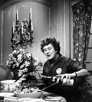 Julia Child pouring a glass of wine at the end of an episode of The French Chef, 1965