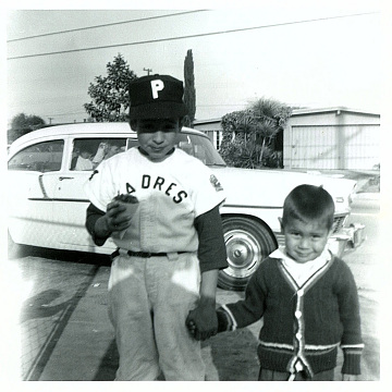 Brothers Ernie and Howard Martinez ready for a game, La Puente, California, 1963
