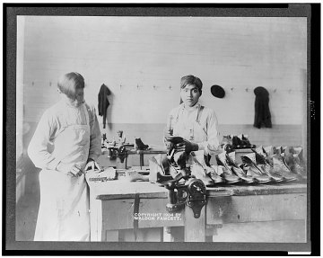 Two boys making or repairing shoes at Carlisle Indian Industrial School, 1904