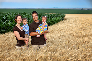 Corn and soybean farmers Zach and Anna Hunnicutt and their children in Giltner, Nebraska.