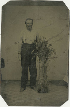Farmer and sheaf of wheat, 1860s