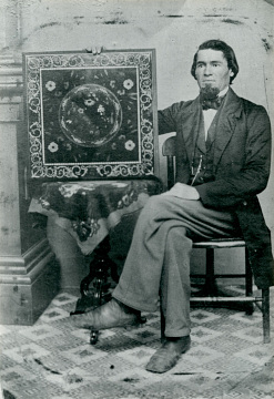 Peter Glass with one of his inlaid wood tables, 1860s