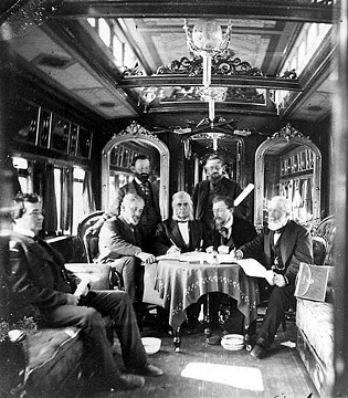 Detail from stereo view of Union Pacific board members and others in company business car, 1869