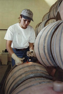 Gloria Ceballos topping off barrels, 1997