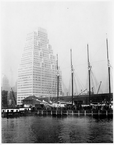 The schooner <i>R. R. Govin</i>, still operating in 1933, dwarfed by a new skyscraper at 120 Wall Street.