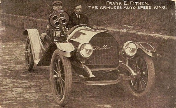 Postcard of Frank Fithen, showing him driving his vehicle adapted for armless driving
