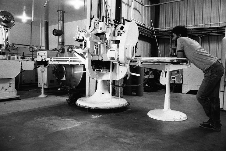 Sierra Nevada founder Ken Grossman working at the labeler, around 1980