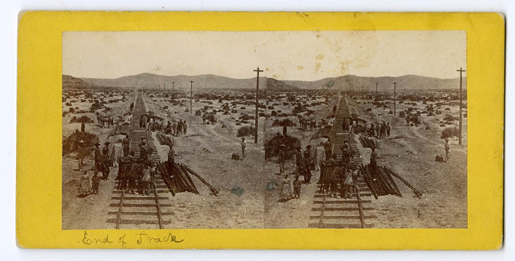 Near Humboldt Lake, Nevada, about 1868, Chinese workers transferring track to an installation handcart.