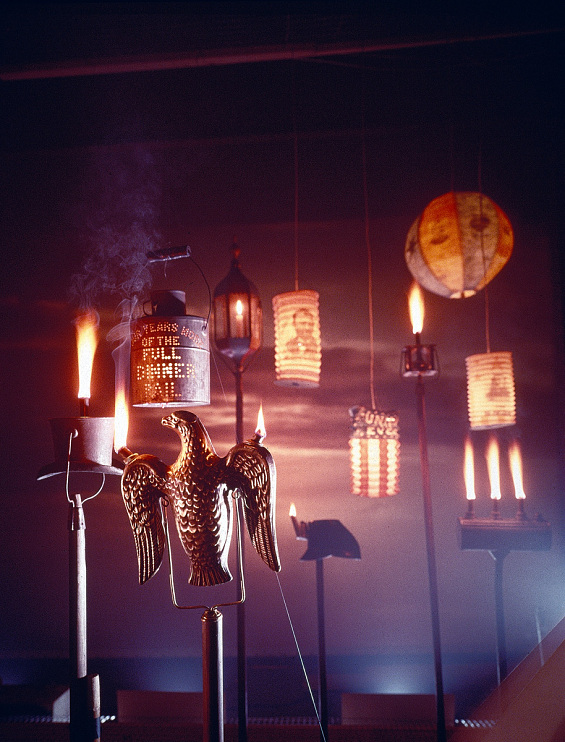 Campaign torches and lanterns, lit for a magazine photo shoot, 1960