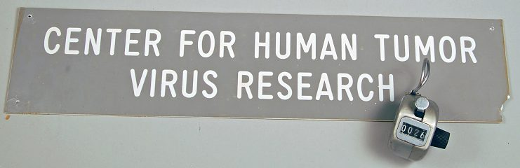 Center for Human Tumor Virus Research sign and counter, 1983