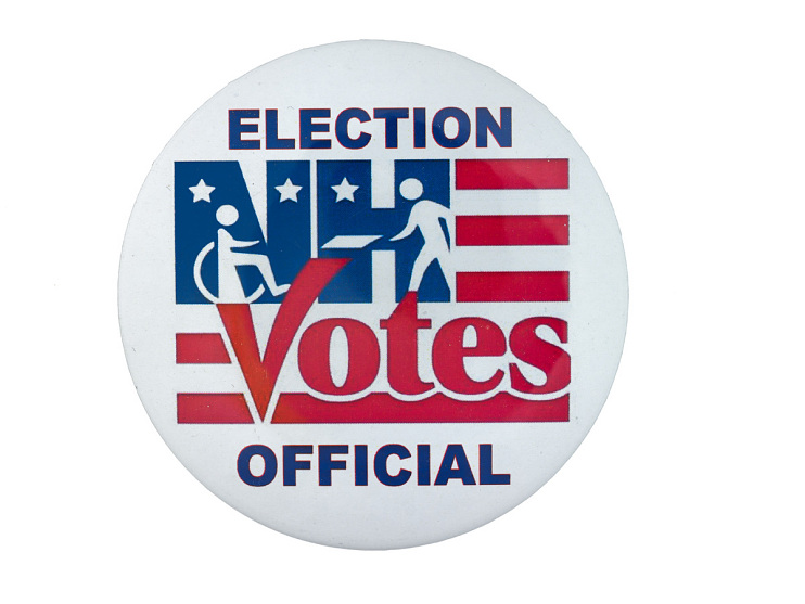 Election official's button from the New Hampshire primaries, 2008