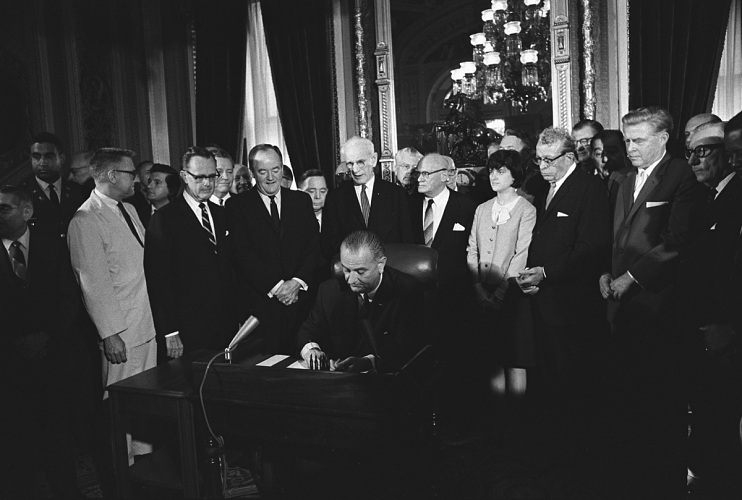 President Lyndon Johnson signing the Voting Rights Act