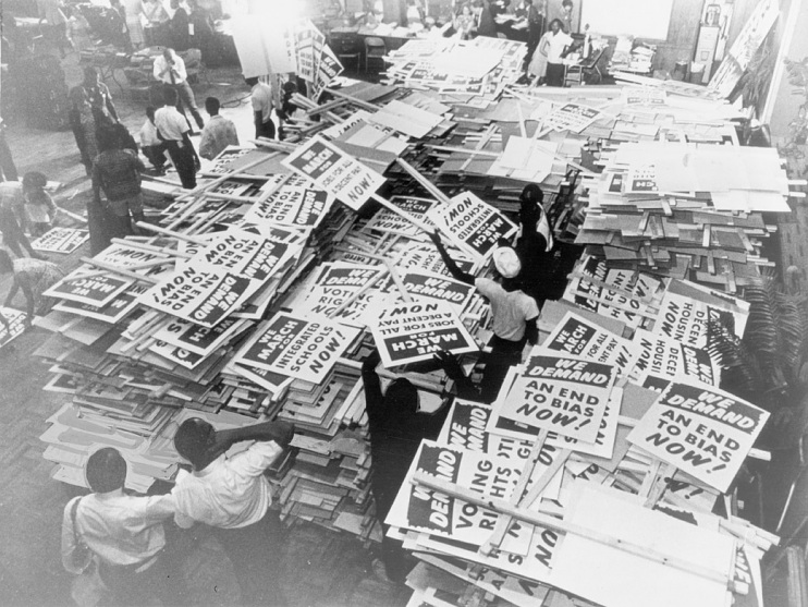 Piles of signs ready to be picked up by marchers for the 1963 March on Washington for Jobs and Freedom