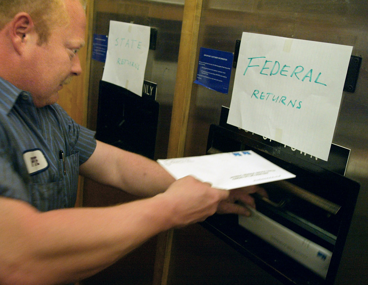 Last-minute taxpayer submitting his federal returns, Des Plaines, Illinois, April 15, 2002
