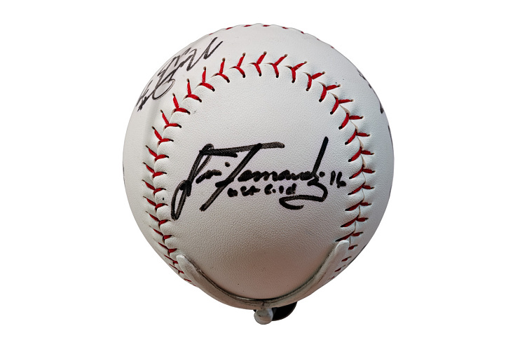 Ball signed by members of the 2004 Olympic softball team, including Lisa Fernandez, 2004