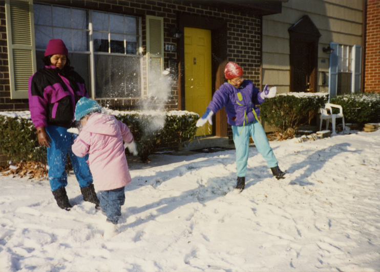 Lares family having a snowball fight at home in Maryland, 1992