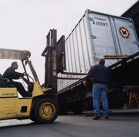 Lifting the container onto a flatbed truck