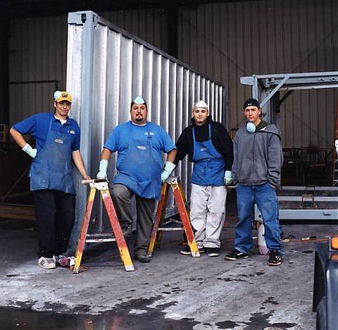 Members of the container refurbishing crew