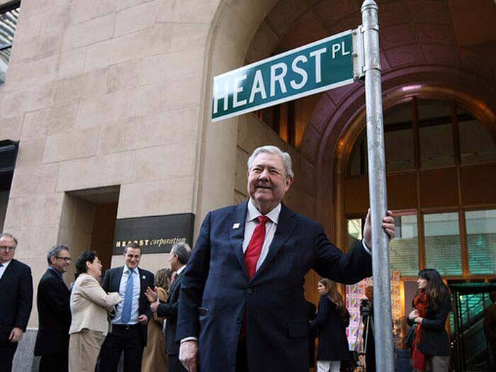 Frank Bennack, 2010, standing in front of the gleaming new Hearst Tower in New York during his second tenure as CEO