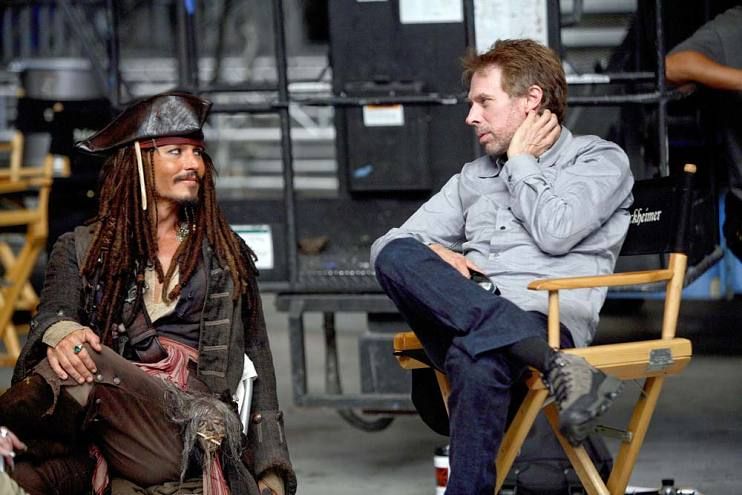 Johnny Depp in character as Jack Sparrow talks to producer Jerry Bruckheimer on the set of Pirates of the Caribbean: Dead Man's Chest, 2005