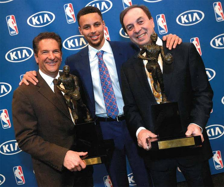 Peter Guber, two-time MVP Stephen Curry, and Joe Lacob celebrating after the Warriors' 2015 NBA Championship