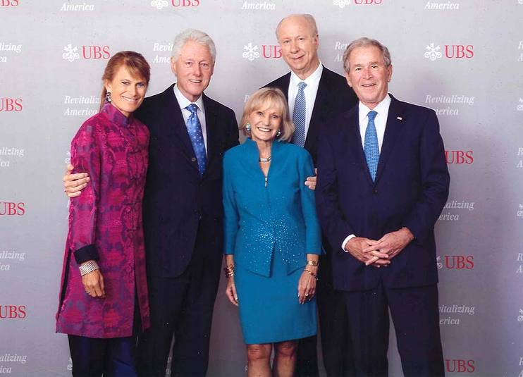 "Kay Koplovitz (center) at the UBS conference ""Revitalizing America, The Road to Sustainable Growth,"" with (from left to right) Jacqueline Novogratz, President Bill Clinton, David Gergen, and President George W. Bush"