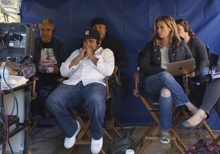 Katie Elmore Mota, executive producer and director of East Los High, sits in video village on the set of East Los High season 4