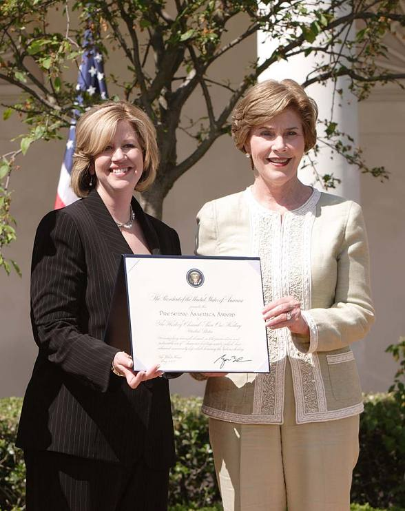 First Lady Laura Bush honors The History Channel and Abbe Raven with a Preserve America Presidential Award in 2007 at the White House