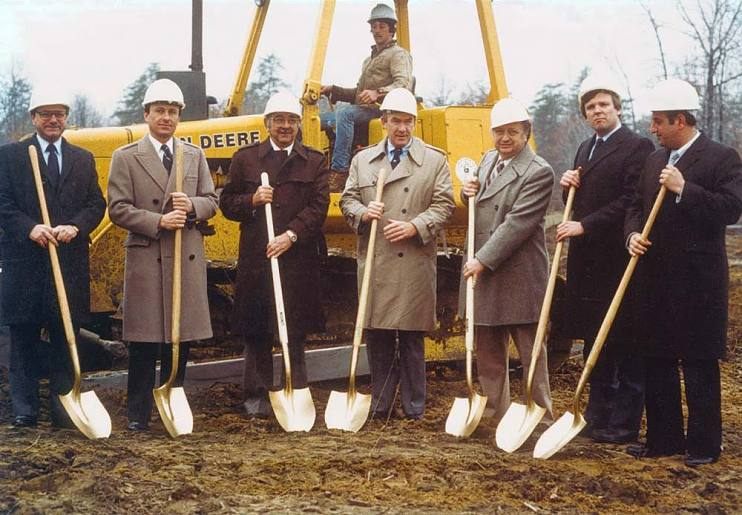 Tom Rutledge at a groundbreaking ceremony with public officials, including the mayor, in Albany in 1984