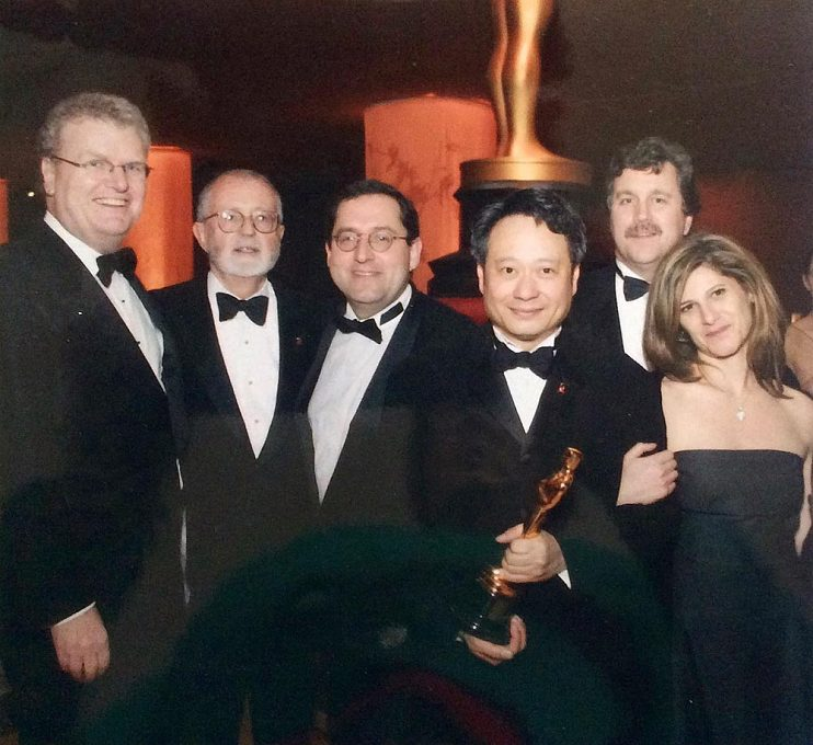 After an Academy Award win for Crouching Tiger, Hidden Dragon with (left to right) John Calley, Michael Barker, Ang Lee, Tom Bernard, and Amy Pascal, 2001