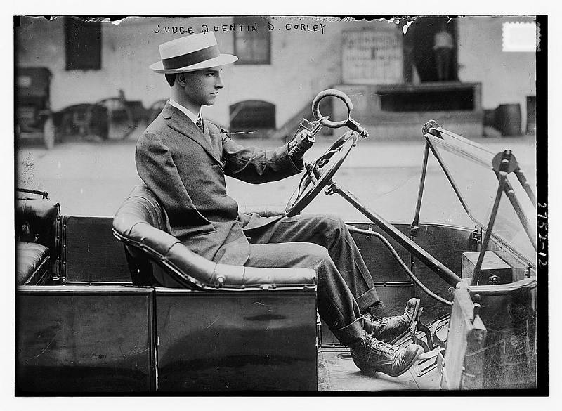 Judge Quentin D. Corley driving his automobile.