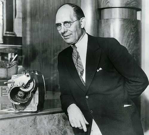Charles Kettering posing with his invention of the self-starter