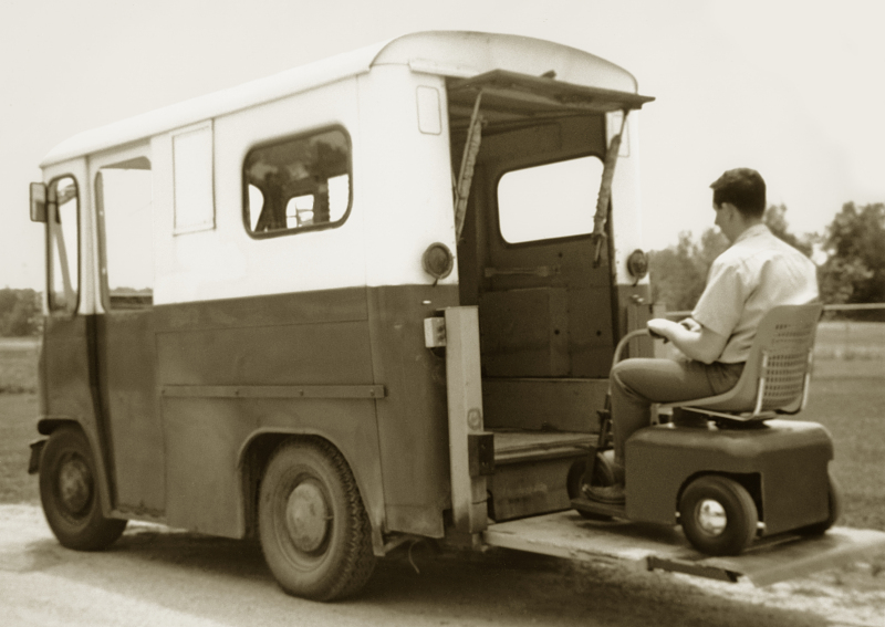 One of the retail models of Braun's Tri-Wheeler entering the van using his  lift.