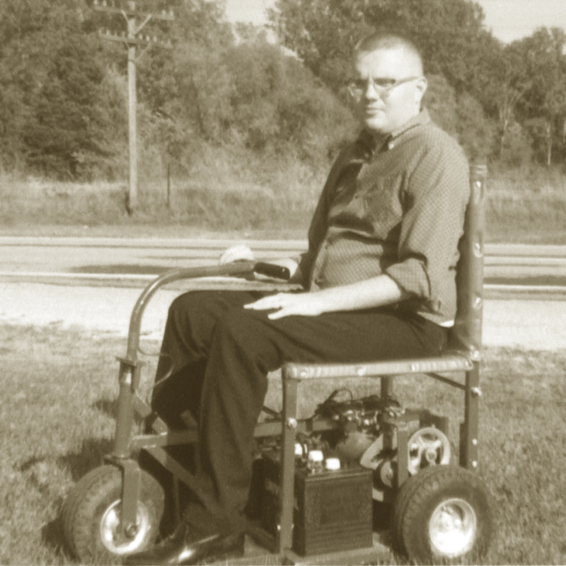 Ralph Braun posed on one of his early scooter designs.